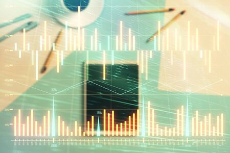 Double exposure of forex graph on digital tablet laying on table background. Concept of market analysis Stock Photo