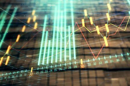 Holograma de gráfico financiero con fondo abstracto. Exposición doble. Concepto de análisis de mercado Foto de archivo