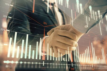 Double exposure of financial chart on cityscape background with two businessmen handshake. Concept of financial analysis and investment opportunities