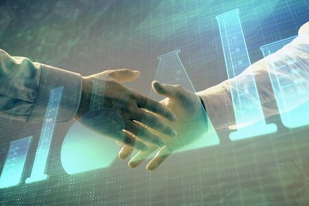 Multi exposure of lab flasks hologram on abstract background with two men handshake. Concept of education Stock fotó