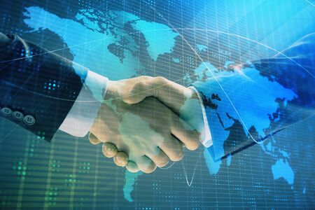 Multi exposure of world map on abstract background with two businessmen handshake. Concept of international business 免版税图像