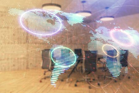 Double exposure of globe hologram on conference room background. Concept of international business