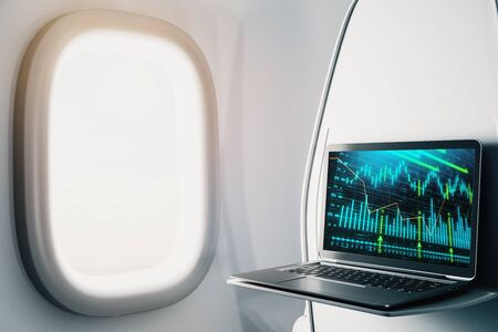 Laptop closeup inside airplane with forex graph on screen. Financial market trading concept. 3d rendering. Standard-Bild - 128548041