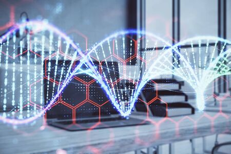 DNA hologram with desktop office background. Double exposure. Concept of education Stock Photo