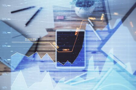 Double exposure of forex graph on digital tablet laying on table background. Concept of market analysis 版權商用圖片
