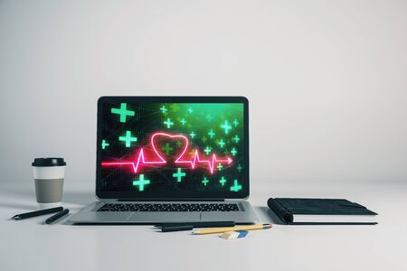 Laptop closeup with human heart drawing on computer screen. Education concept. 3d rendering.