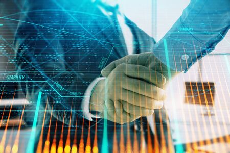 Multi exposure of financial graph on office background with two businessmen handshake. Concept of success in business 写真素材