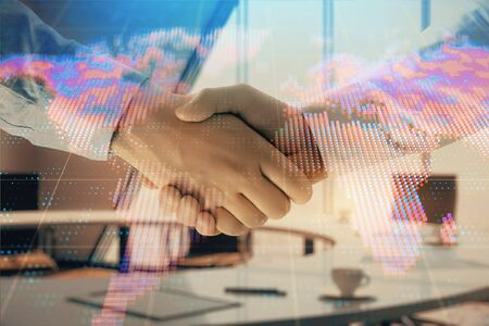 Multi exposure of world map on office background with two businessmen handshake. Concept of international business Stock fotó
