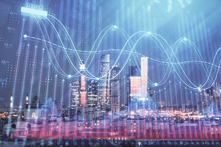 Double exposure of financial chart on Moscow city downtown background. Concept of stock market analysis Stock Photo - 129860251