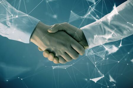 Double exposure of tech drawing on abstract background with two men handshake. Concept of technology in modern business 写真素材