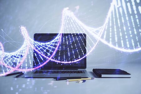DNA hologram with desktop office background. Double exposure. Concept of education 스톡 콘텐츠