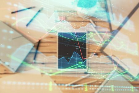 Double exposure of forex graph on digital tablet laying on table background. Concept of market analysis 版權商用圖片 - 129864310