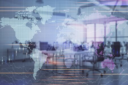 Stock and bond market graph and world map with trading desk bank office interior on background. Multi exposure. Concept of international finance 版權商用圖片 - 129864317