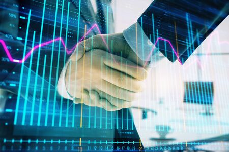 Multi exposure of financial graph on office background with two businessmen handshake. Concept of success in business 版權商用圖片 - 129864339