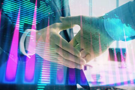 Multi exposure of financial chart and map on office background with two businessmen handshake. Concept of success in business 版權商用圖片 - 129864346