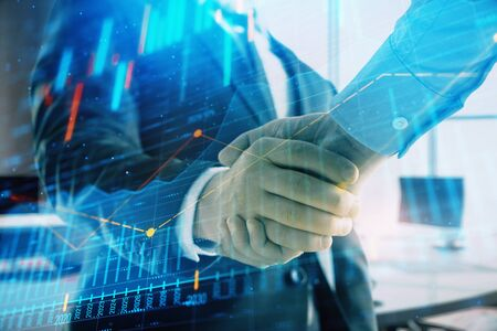 Multi exposure of financial graph on office background with two businessmen handshake. Concept of success in business 版權商用圖片 - 129864355