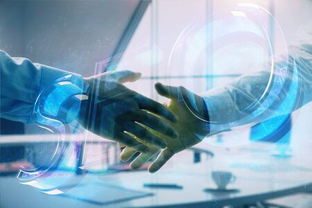 Multi exposure of seo icon hologram on office background with two men handshake. Concept of data search