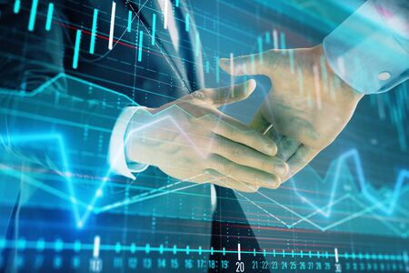 Multi exposure of forex graph on abstract background with two businessmen handshake. Concept of success on stock market 版權商用圖片 - 129863969