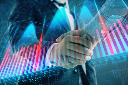 Multi exposure of forex graph on abstract background with two businessmen handshake. Concept of success on stock market 版權商用圖片 - 129863973