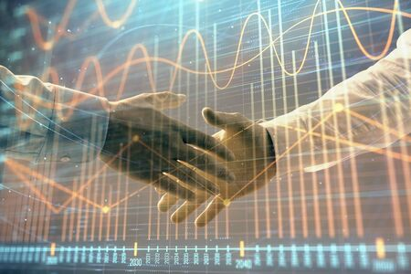 Multi exposure of forex graph on abstract background with two businessmen handshake. Concept of success on stock market 版權商用圖片 - 129863984