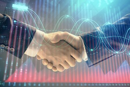 Multi exposure of forex graph on abstract background with two businessmen handshake. Concept of success on stock market 版權商用圖片 - 129864377