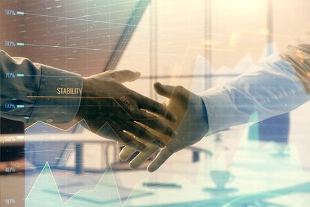 Multi exposure of financial graph on office background with two businessmen handshake. Concept of success in business 版權商用圖片 - 129864409