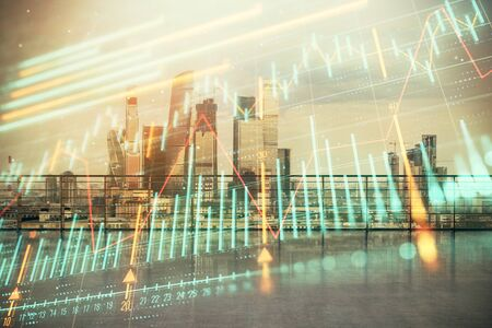 Forex graph hologram with city view from roof background. Double exposure. Financial analysis concept. Stock Photo - 129864134
