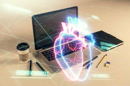 Heart hologram with desktop office background. Double exposure. Concept of medical education Stock fotó