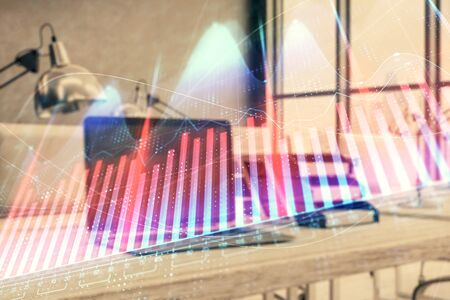 Forex graph hologram with desktop office computer background. Double exposure. Concept of financial analysis.