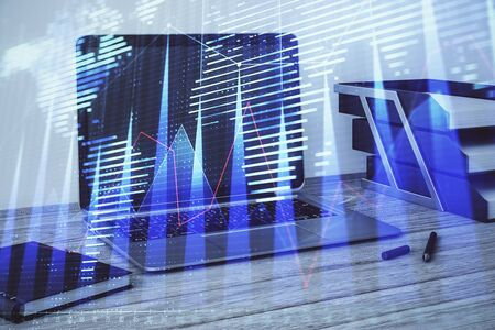 Stock market chart with globe hologram and desktop office computer background. Multi exposure. Concept of financial analysis. 版權商用圖片 - 129864460