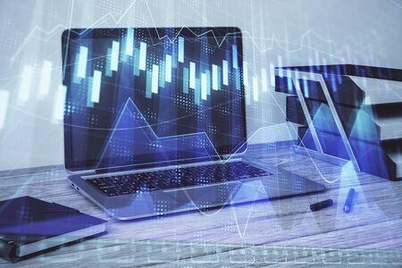 Stock market chart and desktop office computer background. Multi exposure. Concept of financial analysis. 版權商用圖片 - 129864462