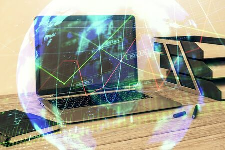 Stock market chart with globe hologram and desktop office computer background. Multi exposure. Concept of financial analysis. 版權商用圖片 - 129864147