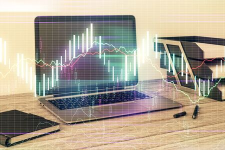 Stock market chart and desktop office computer background. Multi exposure. Concept of financial analysis. 版權商用圖片 - 129864151