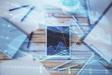Double exposure of forex graph on digital tablet laying on table background. Concept of market analysis Zdjęcie Seryjne