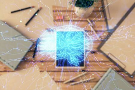 Double exposure of human brain drawing on digital tablet, table background. Concept of data analysis