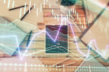 Double exposure of forex graph on digital tablet laying on table background. Concept of market analysis 版權商用圖片 - 129864482