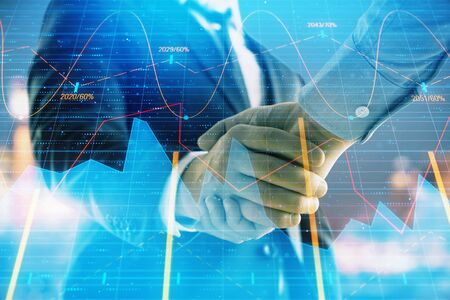 Double exposure of financial chart on cityscape background with two businessmen handshake. Concept of financial analysis and investment opportunities Фото со стока - 129831564