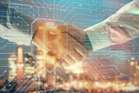 Double exposure of crypto economy theme drawing on cityscape background with handshake. Concept of partnership and blockchain Фото со стока
