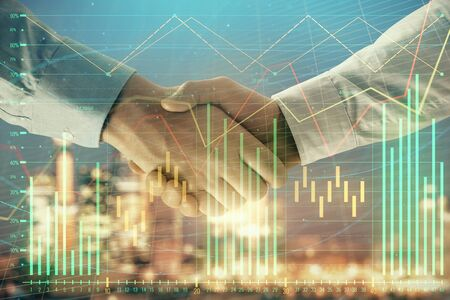 Double exposure of financial chart on cityscape background with two businessmen handshake. Concept of financial analysis and investment opportunities Stok Fotoğraf - 129831573