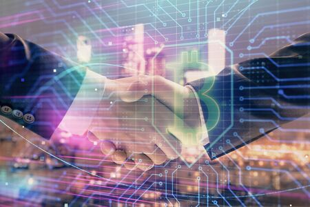Double exposure of crypto economy theme drawing on cityscape background with handshake. Concept of partnership and blockchain Stock fotó