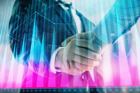 Double exposure of financial graph on cityscape background with two businessman handshake. Concept of stock market deal Stok Fotoğraf - 129831425