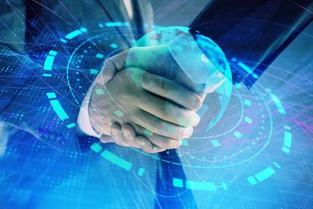 Multi exposure of world map on abstract background with two businessmen handshake. Concept of international business Фото со стока