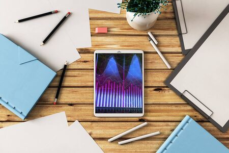 Digital tablet closeup top view with financial graph on screen. Online trading application concept. 3d rendering. Standard-Bild - 129800660