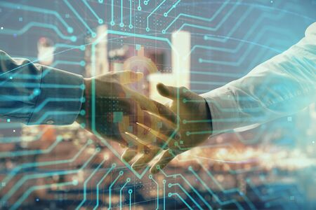 Double exposure of business theme drawing on cityscape background with handshake. Concept of partnership Stock fotó