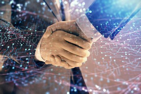 Double exposure of tech drawing on abstract background with two men handshake. Concept of technology in modern business Stock fotó