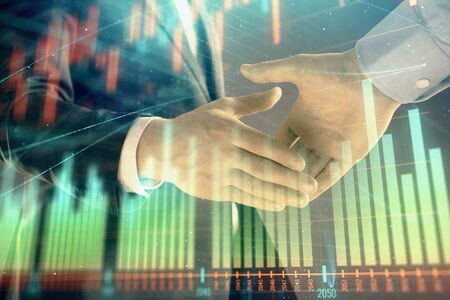 Multi exposure of forex graph on abstract background with two businessmen handshake. Concept of success on stock market Stok Fotoğraf - 129831662