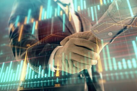 Multi exposure of forex graph on abstract background with two businessmen handshake. Concept of success on stock market