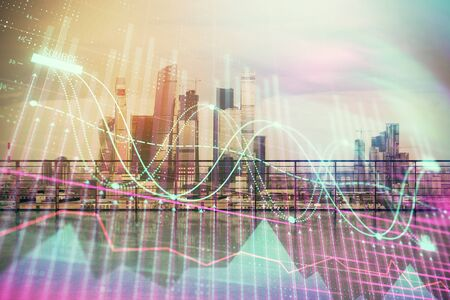 Forex graph hologram with city view from roof background. Double exposure. Financial analysis concept. Stockfoto