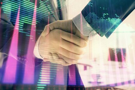 Multi exposure of financial chart and map on office background with two businessmen handshake. Concept of success in business Stockfoto - 129734854