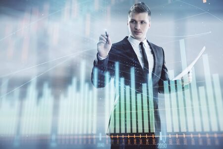 Businessman and forex graph hologram. Double exposure. Concept of financial education and analysis Stock Photo